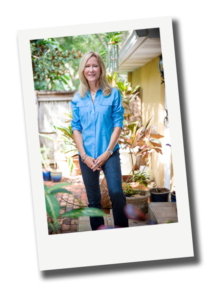 Beth Dillaha standing outside among plants