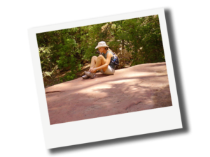 Beth Dillaha resting while on a hike