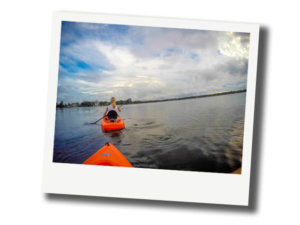 Beth Dillaha kayaking in a lake